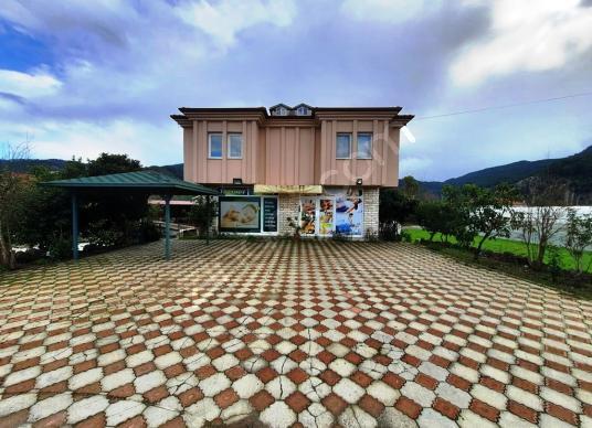 Muğla Okçularda müstakil bahçeli komple bina 3 apart 2 dükkan