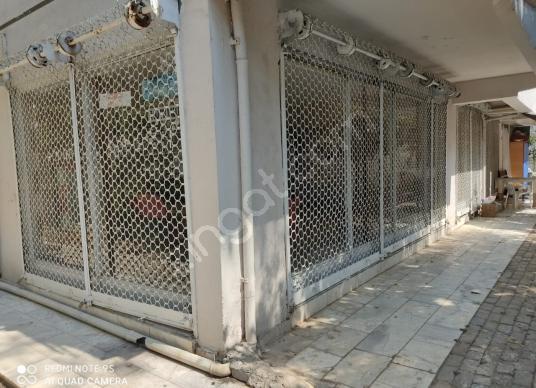 Buca koop'ta site içerisinde her işe uygun içi yapılı dükkan - Balkon - Teras