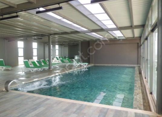 Bayraklı Ontan Residence Satılık 1+1 Daire Elvan Erdemgil den - Yüzme Havuzu
