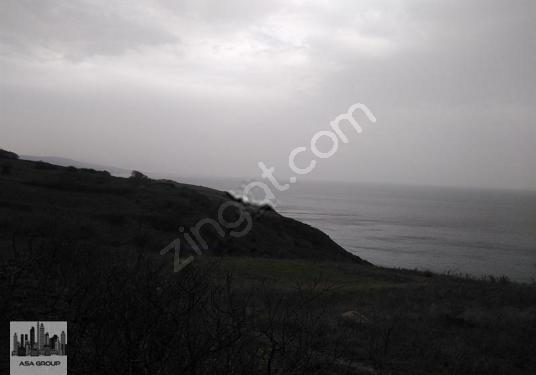 eşkelde deniz manzaralı kadastro yoluna cephesi olan 1400 metre - Arsa