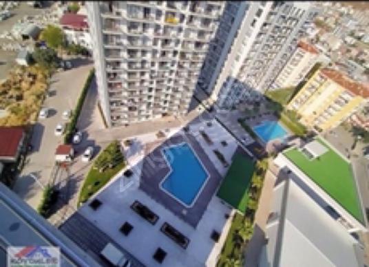 Çiğli Balatçık'ta Marka 333 site içerisinde havuzlu güvenlikli - Site İçi Görünüm