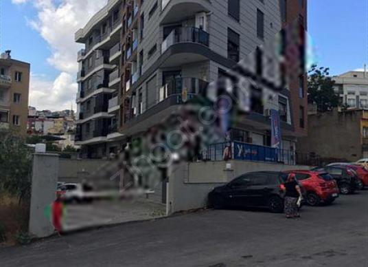 BORNOVA ERZENE MAH. KURUMSAL KİRACILI SATILIK DÜKKAN - Sokak Cadde Görünümü