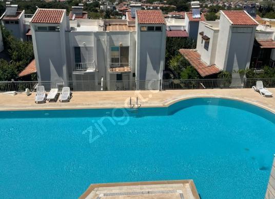 Kuşadası Güzelçamlı'da havuzlu deniz manzaralı 3+1 satılık villa - Yüzme Havuzu